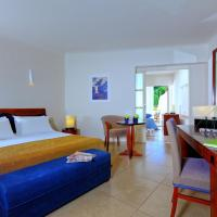 Junior Suite with Sea View (3 Adults + 1 Child)