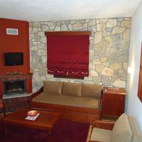 Suite with Fireplace and Balcony