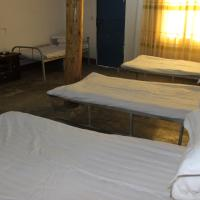 Bed in Female Dormitory Room with Shared Bathroom