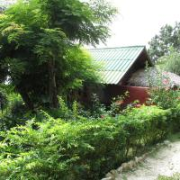 Bouganvilla Bungalow with Sea and Garden View