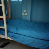 Bed in 4-Bed Male Dormitory Room with Shared Bathroom