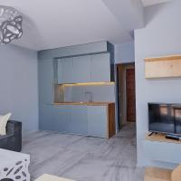 One-Bedroom Apartment with Balcony with Partial Sea View (4 Adults)