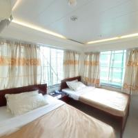 Quadruple Room with Street View and 2 Double Beds