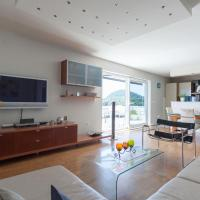 Three-Bedroom Apartment with Terrace and Sea View