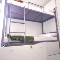 Bed in 12-Bed Mixed Dormitory Room with Shared Bathroom