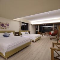 Deluxe Quadruple Room with Side Sea View