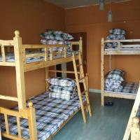 Bed in 6-Bed Male Dormitory Room with Balcony