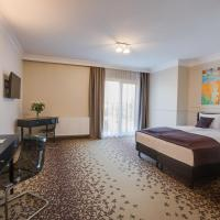 Deluxe Triple Room with Side Sea View