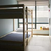Bed in 8-Bed Male Dormitory Room with Ocean View