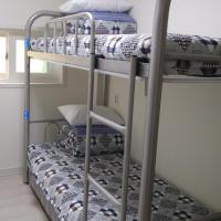 Basic Bunk Room with Shared Bathroom