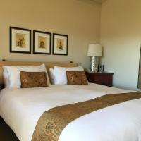 Deluxe Double Queen Room with Partial Ocean View