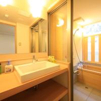 Deluxe Twin Room with Tatami Area and Semi Open-Air Bath - Non-Smoking - River View