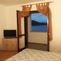 Three-Bedroom Apartment with Balcony and Sea View