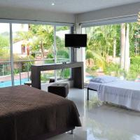 Family Room with Balcony and Pool View