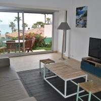 One-Bedroom Apartment with Garden and Sea View