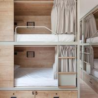 Bed in 8-Bed Dormitory Room with Shared Bathroom