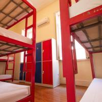 Bed in 9-Bed Dormitory Room with External Shared Bathroom