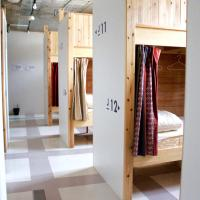 Bed in 12-Bed Female Dormitory Room