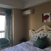 Фотографии отеля: Dalian Mango Apartment, Далянь