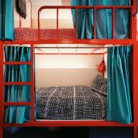 Bed in 16-Bed Mixed Dormitory Room with Shared Bathroom