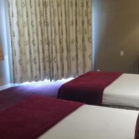 Deluxe Queen Room with Two Queen Beds - Pool View