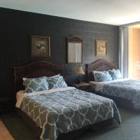 Queen Suite with Two Queen Beds and Pool View