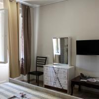 Deluxe Quadruple room with City view