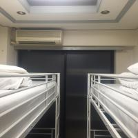 Two-Bedroom Apartment with Bunk Beds and Shared Bathroom
