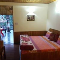 Hotellbilder: Majestic Woods Cottage, Manāli