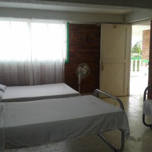 Hotel Pictures: Hotel Villa Linda Prado, Tomogo