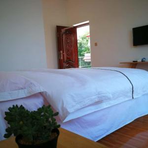 Hotelbilder: Jiuhuang Mountain Laojia Inn, Mianyang