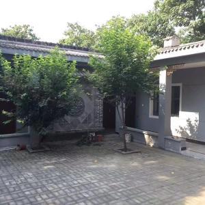 Hotel Pictures: Mountain Hua Zhu Shang Guesthouse, Weinan