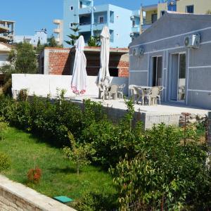Фотографии отеля: Holiday Apartments, Ксамил