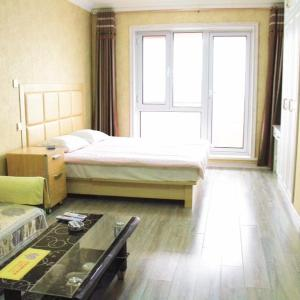Hotel Pictures: Bayu Circle Shanhai Plaza Sea View Apartment, Yingkou