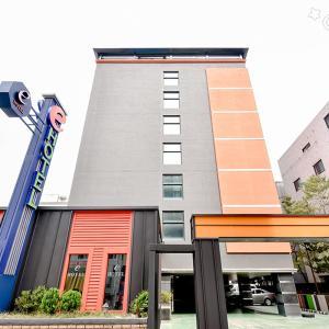 Fotografie hotelů: E Business Hotel, Gumi