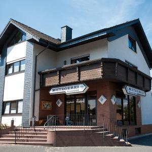 Hotelbilleder: Ferienwohnung 'über dem Schlaraffenland', Horhausen
