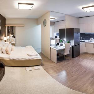 Фотографии отеля: Deluxe Apartments Na Ulitse Raboche-Krestyanskoy 3, Волгоград