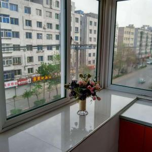 Hotel Pictures: Meiguiyuan Family Theme Apartment, Tieling