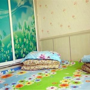 Hotel Pictures: Xueyu Family Inn (Youmuning community ), Qilian