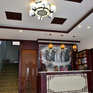 Hotel Pictures: Wanning Holiday Hotel, Qingyang
