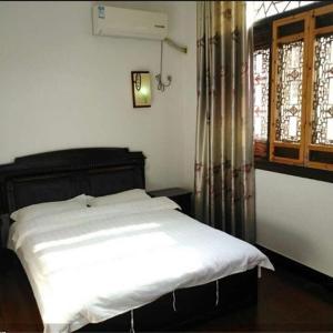 Hotel Pictures: Wuyuan Baifulou Guest House, Wuyuan