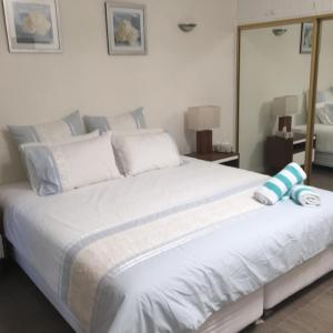 酒店图片: Palm Whispers Bed and Breakfast, 三一海滩