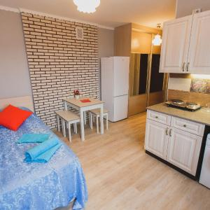 Fotos do Hotel: 9 Nights Apartments on Savinix 4а, Tomsk