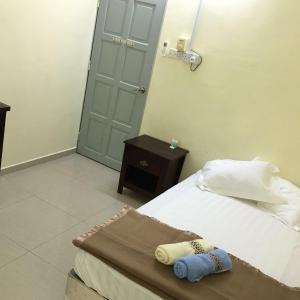 Foto Hotel: Torich Homestay, Sitiawan