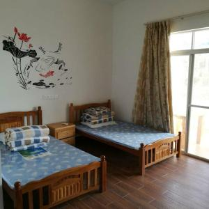 Hotel Pictures: Lucky Bird Cafe Garden Youth Hostel, Wanning